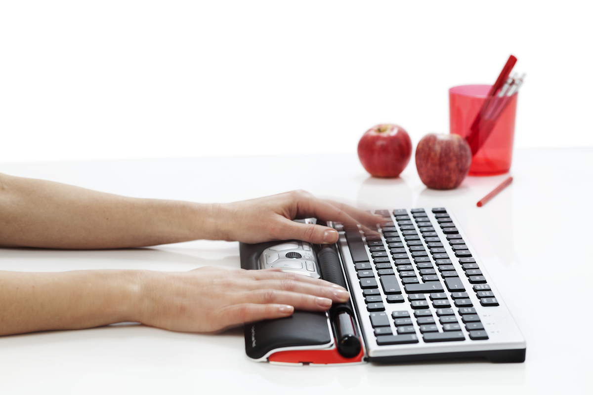 Contour_RollerMouse_Red_perspective_w_wrist_rest_hands_keyboard_black_keys_props_300dpi